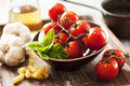 Fresh ingredients for italian pasta wet tomatoes on a stone surface Stock Image