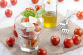 Fresh italian salad in a glass with buffalo mozzarella and cherry tomatoes basil Royalty Free Stock Photo