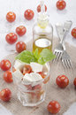 Fresh italian salad in a glass with buffalo mozzarella and cherry tomatoes basil Stock Photos