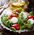 Fresh italian salad with mozzarella cheese Royalty Free Stock Photo