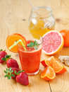 Fresh juice a glass of fruit with fruits and honey jar shallow depth of field Stock Photos