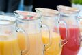 Fresh juice jugs four squeezed Royalty Free Stock Photos