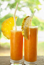 Fresh juice with pineaple slice Royalty Free Stock Photo