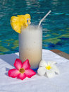 Fresh juice at pool pineapple with flowers Stock Images