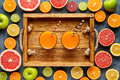 Fresh juice or smoothie with organic citrus fruit, apple, grapefruit on light background. Top view, selective focus Royalty Free Stock Photo