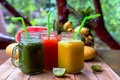 Fresh Juices Smoothie with tropical Fruits Royalty Free Stock Photo