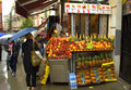 Fresh juices stall istanbul colorful pineapple and pomegranates display on and young women buying at street turkey Royalty Free Stock Photo