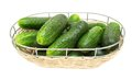 Fresh juicy cucumber in a wicker bowl  isolated Royalty Free Stock Photos