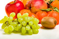 Fresh juicy fruit - bunches of grapes, mandarin, apple. Royalty Free Stock Photo