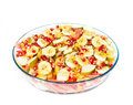 Fresh juicy fruit salad on a big plate on white Royalty Free Stock Photos