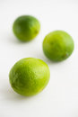 Fresh juicy limes on white wooden background Royalty Free Stock Photo
