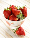 Fresh juicy organic strawberries on wooden table Stock Photography