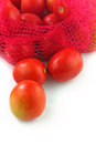 Fresh juicy organic tomatoes on white background Stock Photos