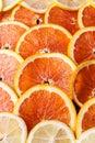 Fresh juicy orange and lemon fruit rings close up background. Royalty Free Stock Photo