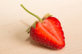 Fresh juicy strawberries on a wood table close up Stock Images