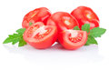Fresh juicy tomato with green leaves isolated on white a background Stock Photo