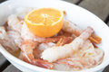 Fresh king prawns with orange sauce Royalty Free Stock Photo