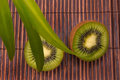 Fresh kiwi fruit on a bamoo mat Royalty Free Stock Photo