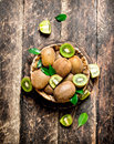Fresh kiwi fruit in the basket. Royalty Free Stock Photo
