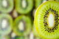 Fresh kiwi fruit slice on kiwi background Royalty Free Stock Images