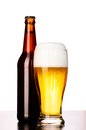 Fresh lager beer glass of with bottle cut out from white Stock Image