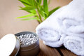 Fresh lavender white towel and bath salt on wooden background wellness spa healthcare Stock Photography