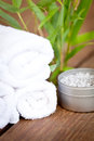 Fresh lavender white towel and bath salt on wooden background wellness spa healthcare Royalty Free Stock Photography