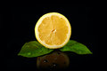 Fresh lemon with drops of water on black background Royalty Free Stock Photos