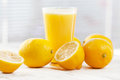 Fresh lemon juice and on vintage table Royalty Free Stock Images
