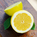 Fresh lemon and lime on wooden table Royalty Free Stock Photos