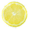 Fresh lemon in soda water covered with bubbles on Royalty Free Stock Photo