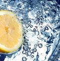 Fresh lemon in water Royalty Free Stock Photo