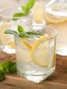 Fresh lemonade cold with lemon selective focus Stock Photos