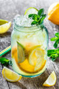 Fresh lemonade with mint, lemon and ice in glass jar on wooden background. Summer drinks and cocktails Royalty Free Stock Photo