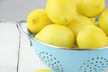 Fresh Lemons in Colander Stock Photo