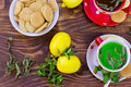 Fresh lemons, mint tea - green tea and tea cakes Royalty Free Stock Photo