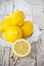 Fresh lemons on rustic wooden background Stock Photo