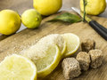 Fresh lemons with sugar young cane brown Royalty Free Stock Photography
