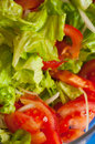 Fresh lettuce and tomato salad in the table ready to meal Stock Photo
