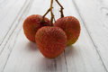Fresh lichees on white wood