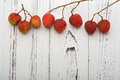 Fresh lichees on white wood background