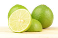 Fresh lime on brown wooden background Royalty Free Stock Photo
