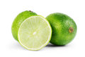 Fresh limes isolated on white Royalty Free Stock Photo