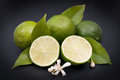 Fresh limes on a slate Royalty Free Stock Images