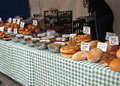 Fresh loaves of bread for sale a stall selling and pies there are various types on this market stall this is in bedford Royalty Free Stock Photography