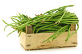 Fresh long beans in a wooden crate