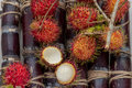 Fresh lychee and peeled showing the red skin Royalty Free Stock Photo