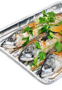 Fresh mackerel fish with parsley on the aluminium foil tray isolated white Royalty Free Stock Image