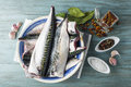 Fresh mackerel to cook a plate with and spices on the kitchen table Stock Photo