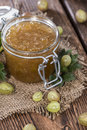 Fresh made gooseberry jam on vintage wooden background Royalty Free Stock Photos